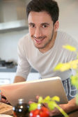 Man looking at recipe on tablet — Stock Photo