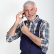 Portrait of artisan with mobile phone — Stock Photo #5696475