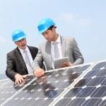 Engineers checking solar panels setup — Stock Photo #5697256