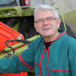 Farmer standing by harvester — Stock Photo #6703118