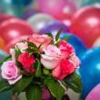 Bridal bouquet on a background of colorful balloons — Stock Photo