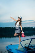 Young beautiful sailor woman jumping on the boat — Stock Photo