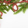 Christmas frame with conifer and red garland — Stock Photo