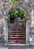 Old closed wrought-iron gates — Stock Photo