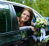 Portrait smiling bride in a car window — Stock Photo