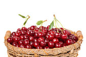 Sweet juicy cherry in basket — Stock Photo