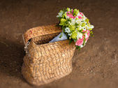 Beautiful bridal bouquet in basket — Stock Photo