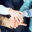Stock Photo: Group of business with hands together