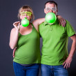 Happy young couple having fun with balloons — Foto de Stock