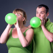 Happy young couple having fun with balloons — Stock Photo #12486869