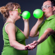 Happy young couple having fun with balloons — Stock Photo