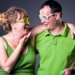 Stock Photo: Happy young couple having fun - studio shot