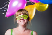 Happy young woman in green glasses — Stock Photo
