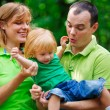 Stock Photo: Portrait of a funny family having fun