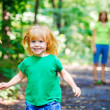 Portrait of Happy Little Girl running in park — Stock Photo #13119535