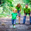 Foto Stock: Portrait of Happy Family In Park