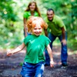 Portrait of Happy Family In Park — Stock Photo #13119547