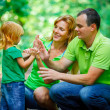 Stock Photo: Portrait of Happy Family In Park