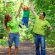 Portrait of Happy Family In Park — Stock Photo #13119560