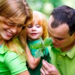 Portrait of Happy Family In Park — Stock Photo #13119561