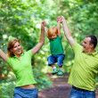 Portrait of Happy Family In Park — Stock Photo #13119565