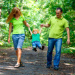 Portrait of Happy Family In Park — Stock Photo #13119566