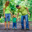 Portrait of Happy Family In Park — Stock Photo #13119567