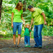Portrait of Happy Family In Park — Stock Photo #13119574