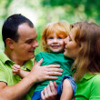 Portrait of Happy Family In Park — Stock Photo #13119576