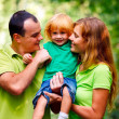 Portrait of Happy Family In Park — Stock Photo #13119580