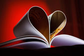 Pages curved into a heart shape — Stock Photo
