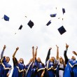 Group of happy young graduates — Stock Photo #13488155