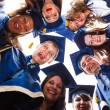 Group of happy young graduates — Stockfoto