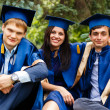 Image of happy young graduates - outdoor shot — 图库照片