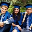Image of happy young graduates - outdoor shot — Foto Stock