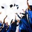 Стоковое фото: Group of happy young graduates