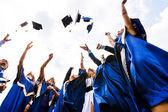 Grupp av glada unga akademiker — Stockfoto