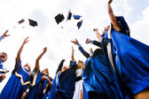 Group of happy young graduates — Stock Photo
