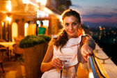 Young beautiful woman on night party went to get some air — Stock Photo