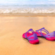 Sandals on the beach - concept image — Stock Photo