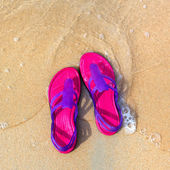 Sandals on the beach - concept image — Foto de Stock