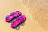 Sandals on the beach - concept image — Stok fotoğraf