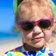 Funny Baby looking at camera on summer beach — Stock Photo