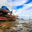 Stock Photo: Thai longtail boats at low tide of the sea