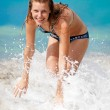 Young beautiful girl having fun in the water — Stock Photo #18258013