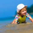 Funny Little girl playing on the beach — Stock Photo
