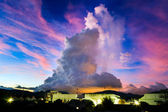Amazing big cloud over the night city — Stock Photo