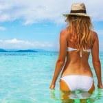 Beautiful young woman in bikini on the sunny tropical beach rela — Stock Photo #18871165