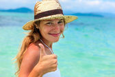Portrait of Beautiful young woman in hat on the sunny tropical b — Stock Photo