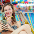 Portrait of a happy woman posing while on the beach — Foto de Stock